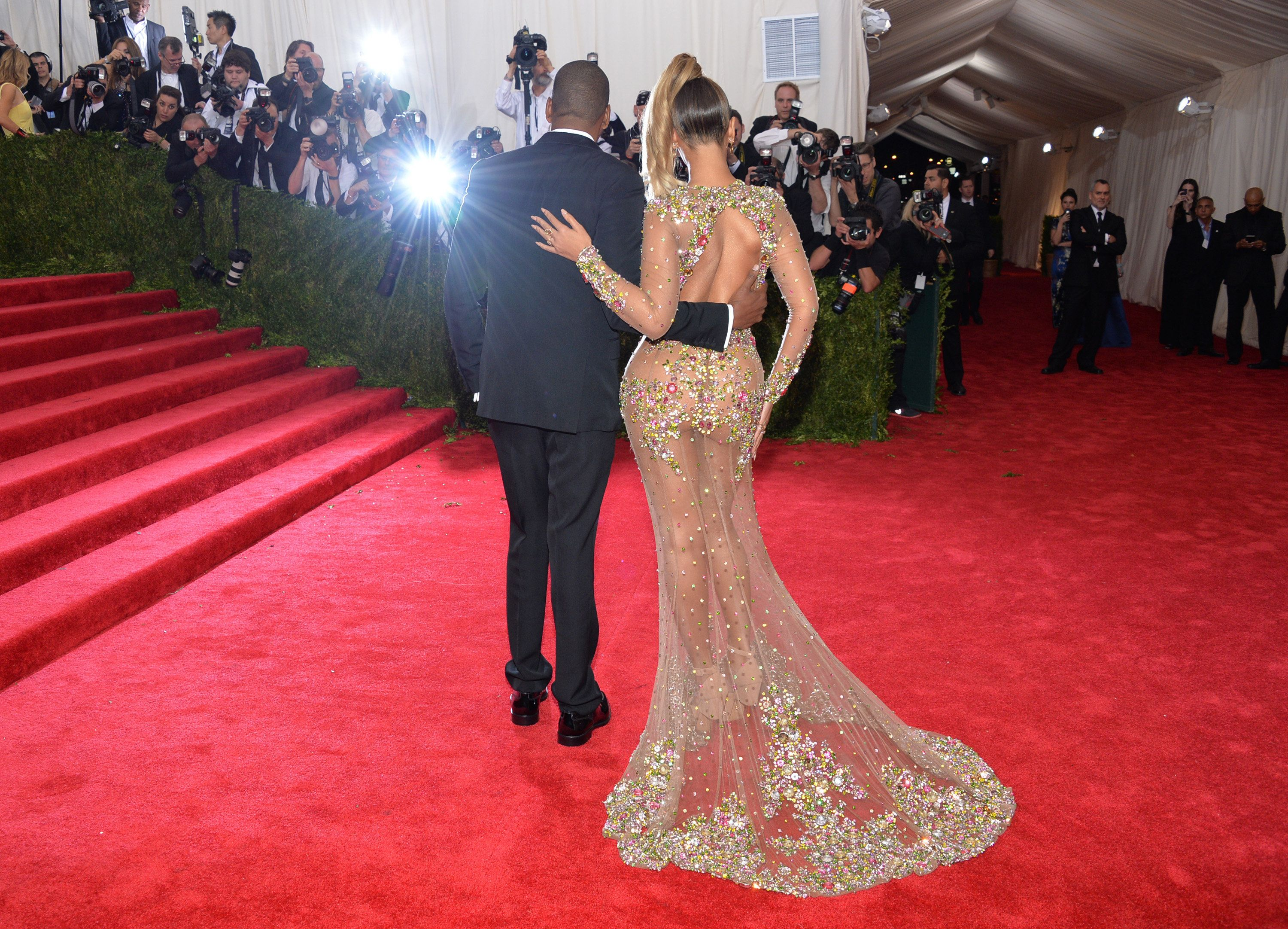 """Jay-Z, left, and Beyonce arrivesat The Metropolitan Museum of Art's Costume Institute benefit gala celebrating """"China: Through the Looking Glass"""" on Monday, May 4, 2015, in New York. (Photo by Evan Agostini/Invision/AP)"""