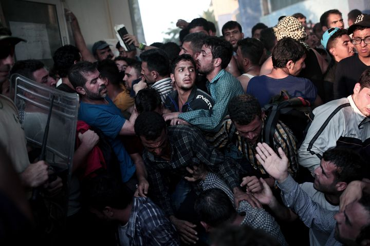 People scuffle as they wait to be registered by the police in the port of Mytilene on Lesbos, Greece, on Sept. 3, 2015.