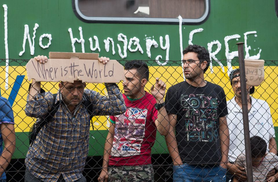 People demonstrate at the Bicske railway station, Hungary, on Sept. 4, 2015.