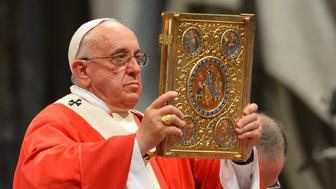 Pope Francis holds aloft the book of the gospels as he leads a mass for the imposition of the Pallium upon the new metropolitan archbishops and the solemnity of Saints Peter and Paul on June 29, 2014 at St Peter's basilica in Vatican.  AFP PHOTO / VINCENZO PINTO        (Photo credit should read VINCENZO PINTO/AFP/Getty Images)
