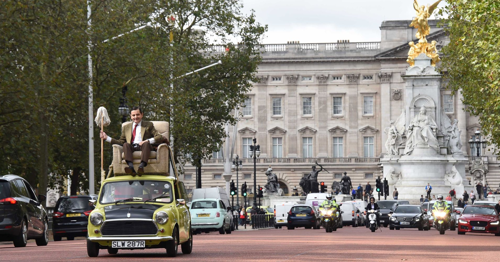 See Mr Bean Drive With A Mop While Reclining Atop His Car In 2015