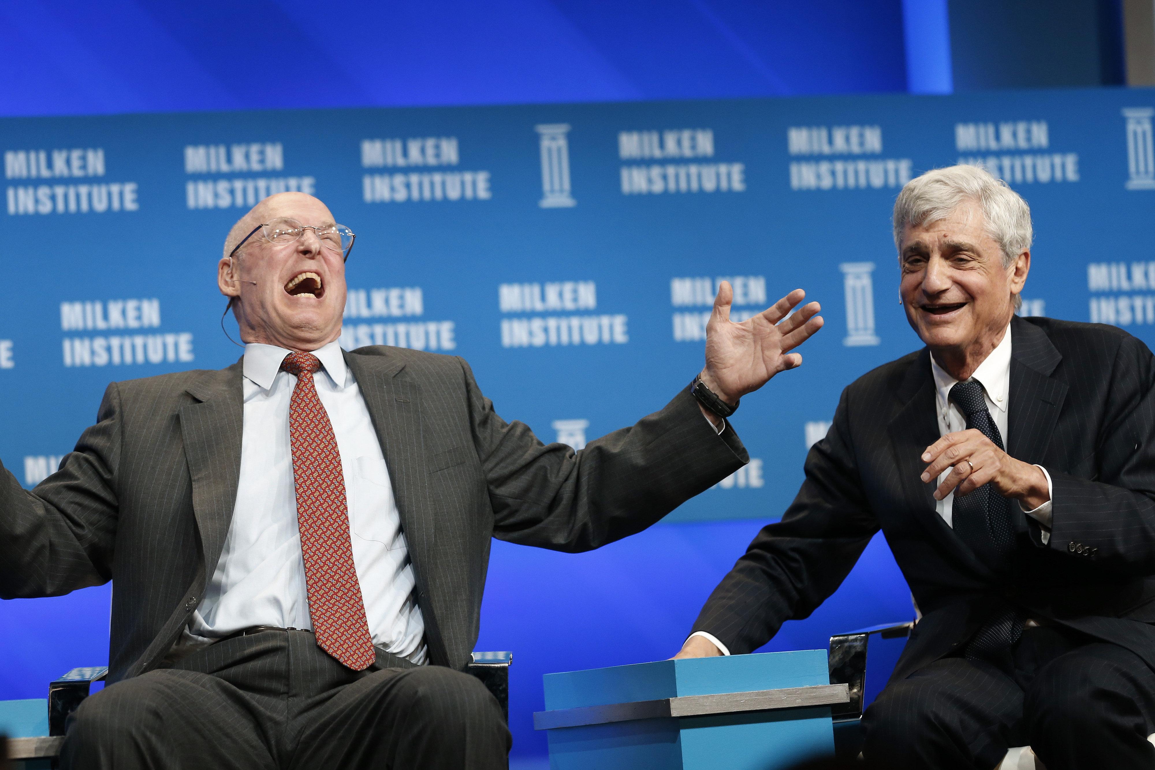 Former Treasury Secretaries Henry Paulson (left) and Robert Rubin havea good laugh about income inequality.
