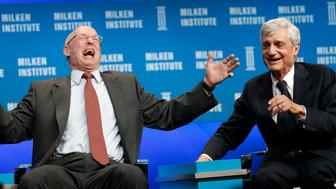 <p>Former Treasury Secretaries Henry Paulson (left) and Robert Rubin have&nbsp;a good laugh about income inequality.</p>