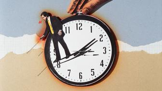 BUSINESSMAN ON HAND OF HANDHELD CLOCK