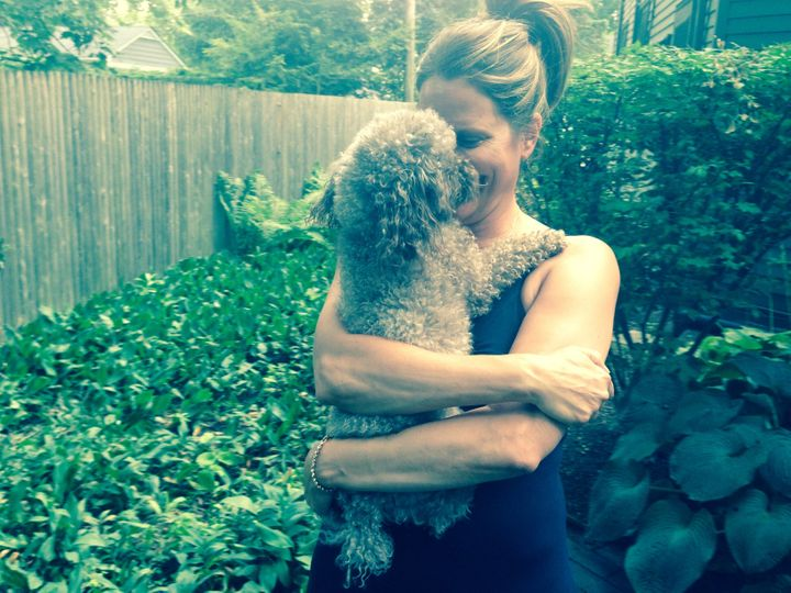 "<p>Susan and her pup Violet in the backyard of her ""empty-nester dream home.""</p>"