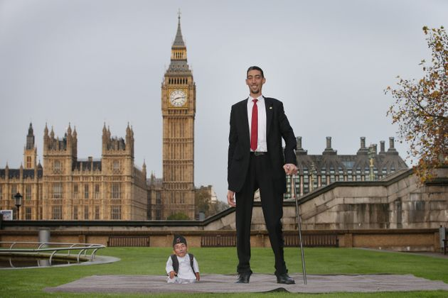 "<span class='image-component__caption' itemprop=""caption"">Chandra Bahadur Dangi met the world's tallest man, Sultan Kosen, in London in November 2014.</span>"
