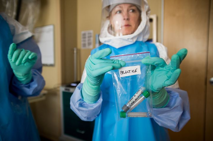 <p>Nurse Jody Walsh holds a bag of empty vials during a&nbsp;University of Minnesota Medical Center's Ebola preparedness drill on June 25, 2015.&nbsp;</p>