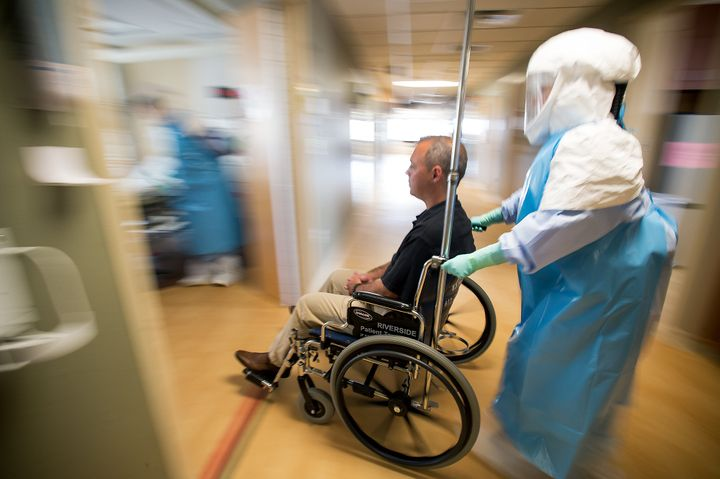 <p>University of Minnesota Medical Center nurses wheel a volunteer through the hospital, recreating the path a&nbsp;potential Ebola patient&nbsp;would take&nbsp;through the facility to its&nbsp;isolation ward.&nbsp;</p>