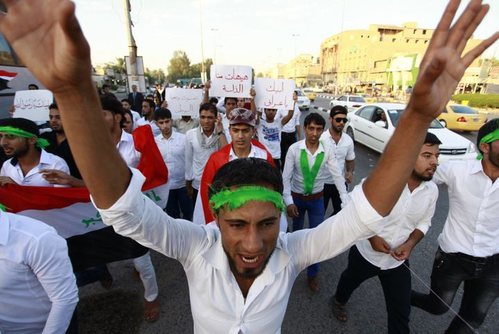 <span>Iraqi men take part in a demonstration to show their support for the call to arms by Shiite cleric Grand Ayatollah Ali