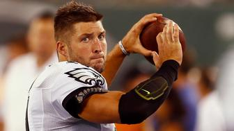 """<p><span style=""""color: #000000; font-family: Verdana, Arial, Helvetica, sans-serif; font-size: 11px; background-color: #ffffff;"""">Quarterback Tim Tebow of the Philadelphia Eagles warms up on the sidelines against the New York Jets on Sept. 3, 2015 in East Rutherford, New Jersey. The team cut Tebow&nbsp;from its roster two days later.</span></p>"""