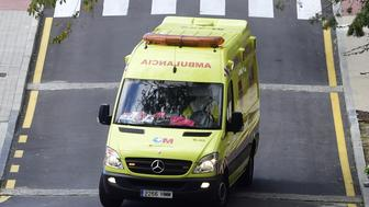 <p>An ambulance drives in Madrid on Oct. 16, 2014.&nbsp;</p>