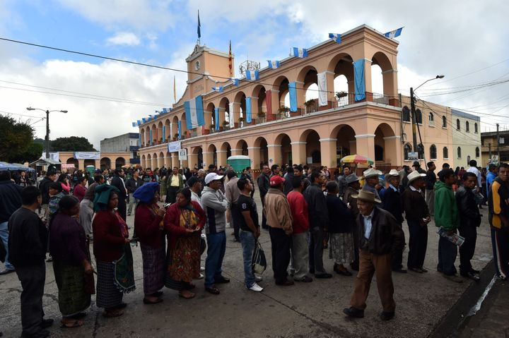 People queue at polling stations in San Juan Sacatepequez, 40 km west of Guatemala City, during general elections on Septembe
