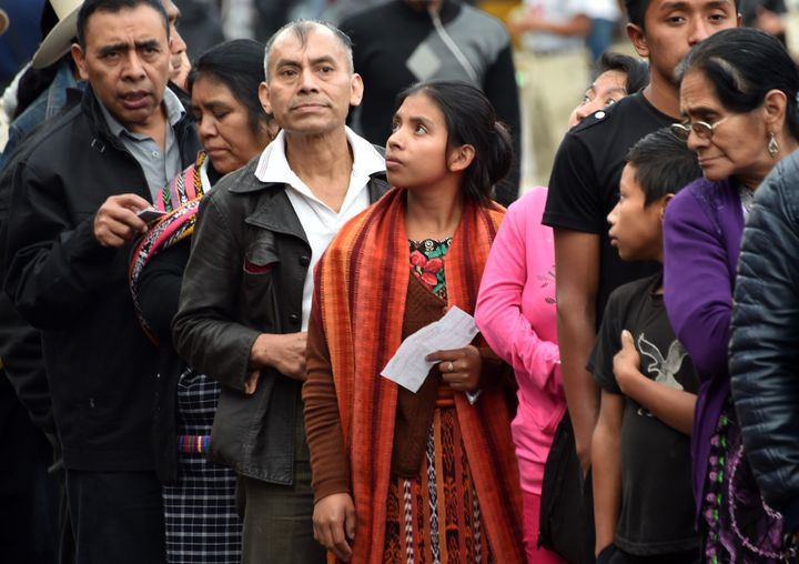 People queue at a polling station in San Juan Sacatepequez, 40 km west of Guatemala City, during general elections on Septemb