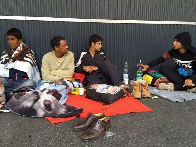 Syrian men rest in Austria.