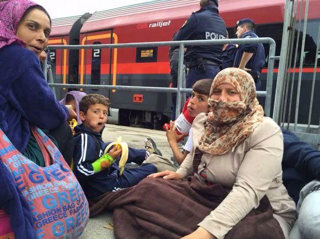 Syrian families wait to board trains in Nickelsdorf, Austria.