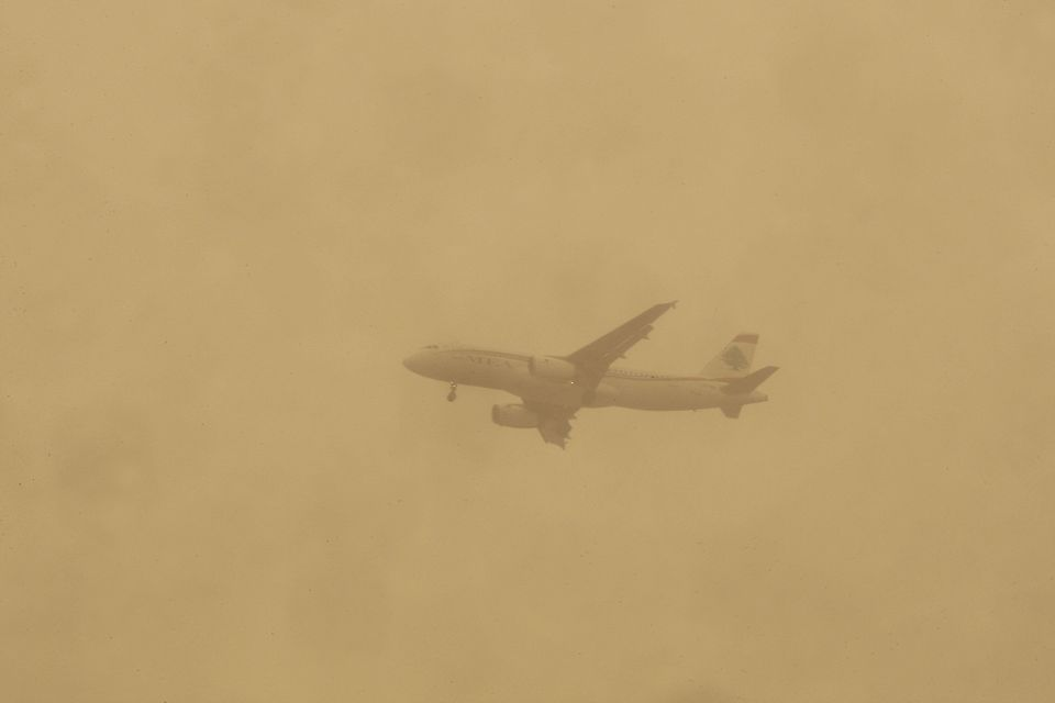 A plane is seen during a sand storm that hit Lebanon's Beirut on Sept. 8,