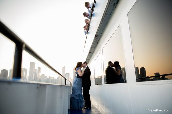 """""""Lenny and Melissa tied the knot in Chicago and celebrated on the dinner cruise on Lake Michigan with their four kids."""" - Ner"""