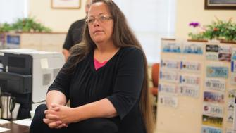 MOREHEAD, KY - SEPTEMBER 2:  Kim Davis, the Rowan County Clerk of Courts, listens to Robbie Blankenship and Jesse Cruz as they speak with her at the County Clerks Office on September 2, 2015 in Morehead, Kentucky. Citing a sincere religious objection, Davis, an Apostolic Christian, has refused to issue marriage licenses to same sex couples in defiance of a Supreme Court ruling. (Photo by Ty Wright/Getty Images)