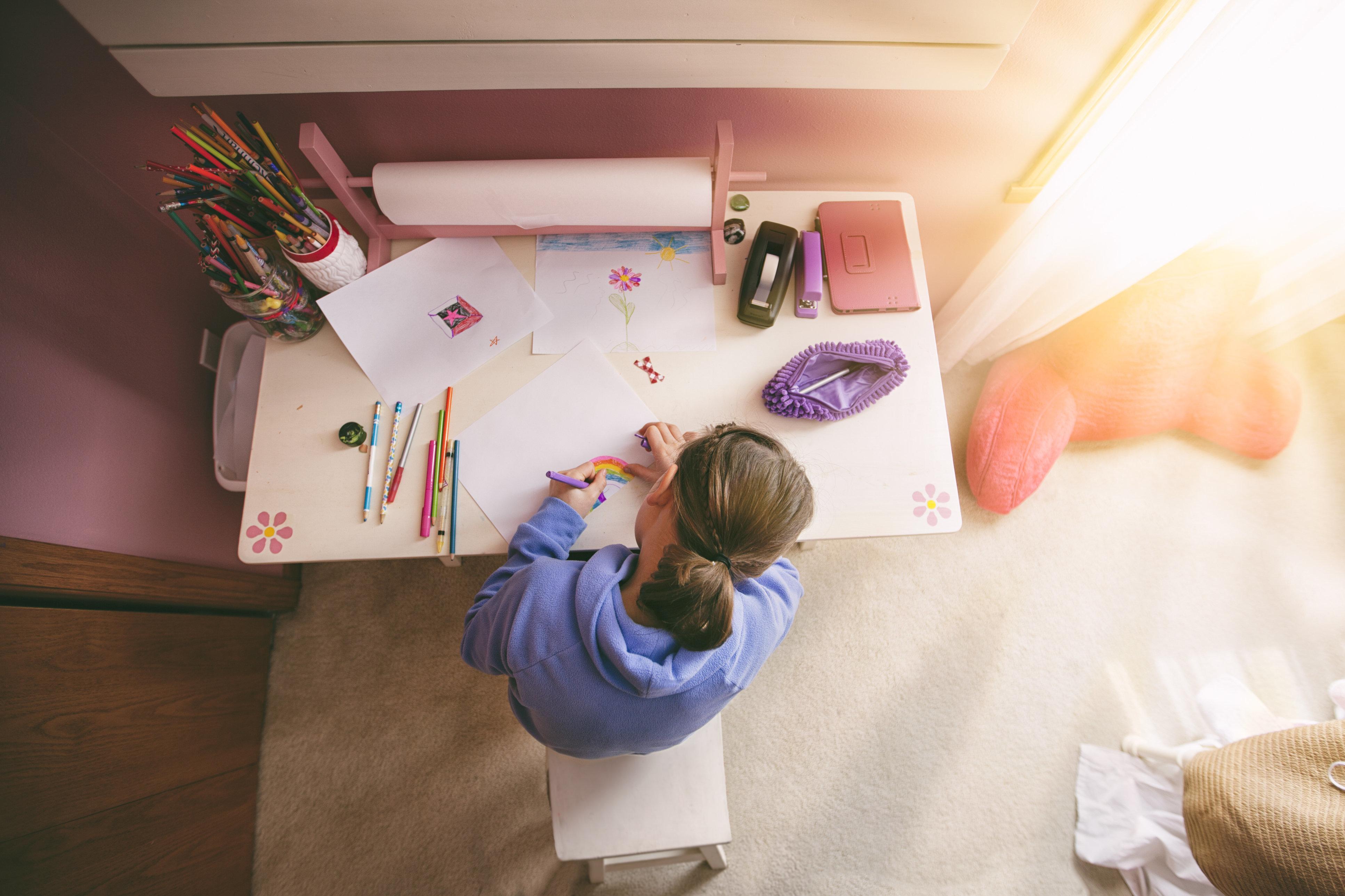 Girl drawing at desk