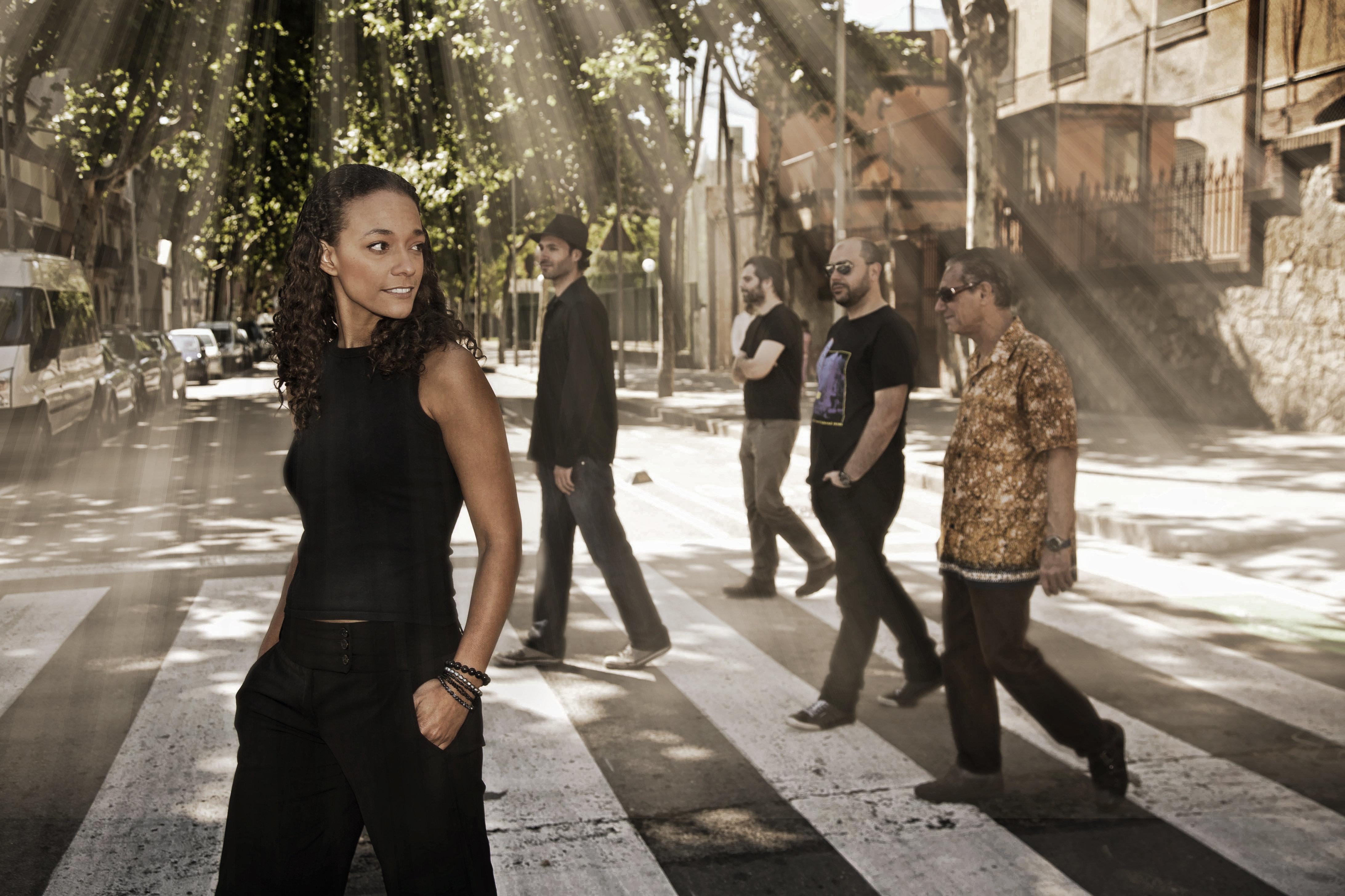 Blues band musicians posing at street.