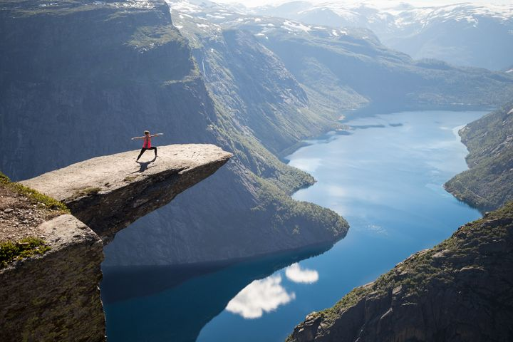 A visitor poses for a photo at Trolltunga, the scenic cliff in Norway where Kristi Kafcaloudis, 24, died on Saturday.