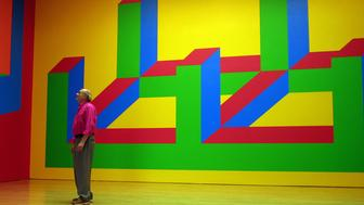 <p>Sol Lewitt is dwarfed by his wall drawing at the Margo Leavin Gallery in Los Angeles. (Photo by Gina Ferazzi/Los Angeles Times via Getty Images)</p>