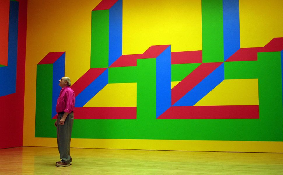 Sol Lewitt is dwarfed by his wall drawing at the Margo Leavin Gallery in Los Angeles. (Photo by Gina Ferazzi/Los Angeles Time