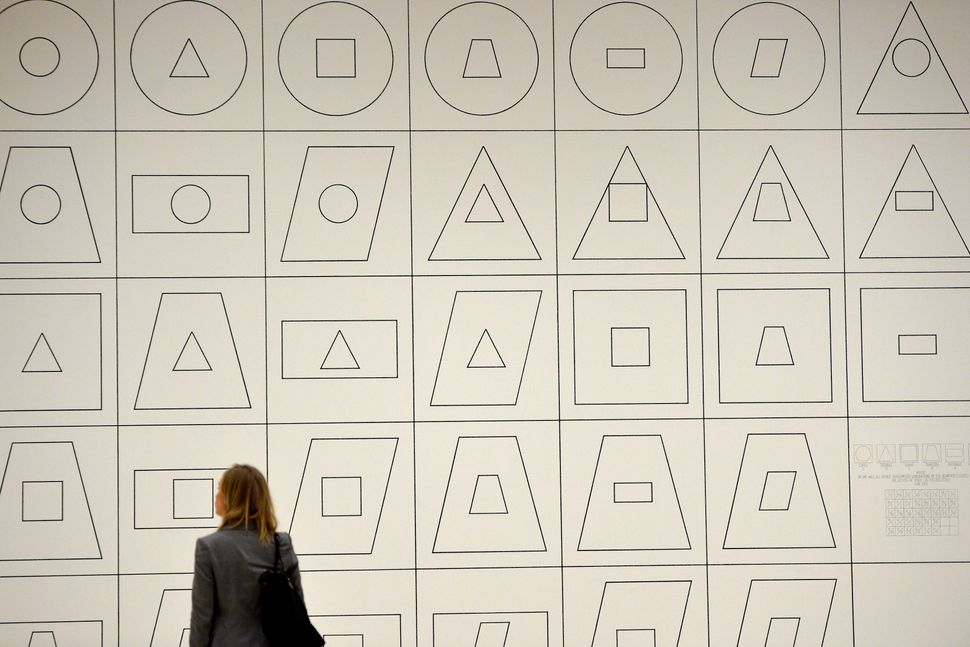 A woman looks at a piece of art by Sol LeWitt. (GABRIEL BOUYS/AFP/Getty Images)