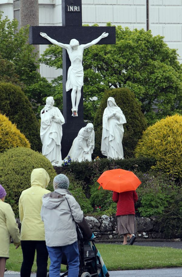 Many Catholics believe that at least 15 people saw Mary appear over the altar of a village chapel in Knock, Ireland, along wi