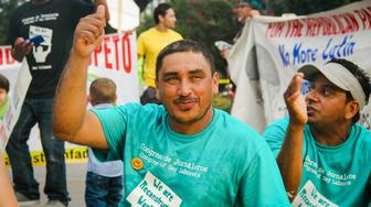 "<p>A man rallies at Congress Of Day Laborers event. Fernando Lopez, an<span style=""font-size: 11px;"">&nbsp;organizer for the group,&nbsp;</span>joined HuffPost Live to discuss the plight of immigrant workers post-Katrina.</p>"