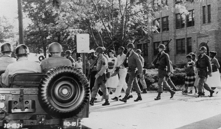 Nine black high school students in Little Rock, Arkansas, are escorted by U.S. paratroopers on Sept. 25, 1957. Gov. Orva