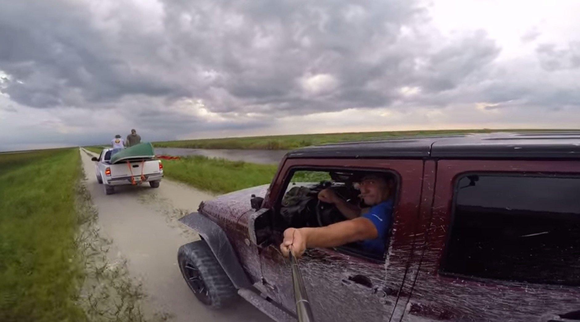 Jeep driver's selfie stick fail.
