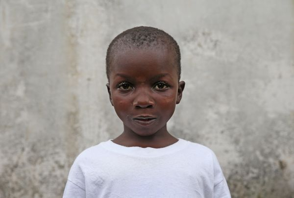 Ebola survivor Abrahim Quota, 5, stands outside the JFK Ebola treatment center after recovering from the disease on October 1