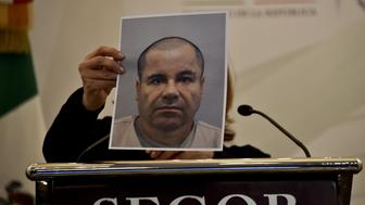 <p>Mexico Attorney General Arely Gomez shows a picture of Joaquin 'El Chapo' Guzman during a press conference in Mexico City, on July 13, 2015.</p>