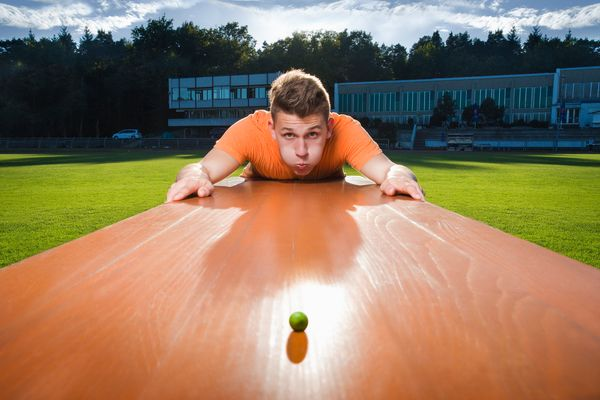 The farthest distance to blow a pea is 24 feet, 7.66 inches. Andre Ortolf of Germany set the record on July 12, 2014 in the B