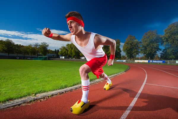 The fastest 100 meter dash wearing clogs is 16.27 seconds. It was achieved by Andre Ortolf of Germany on October 25, 2013.