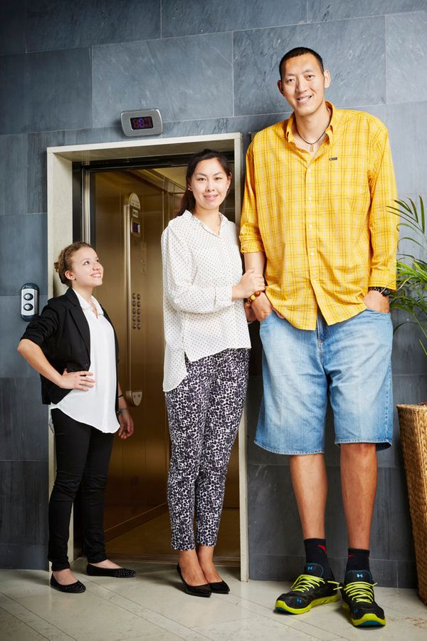 Sun Mingming and his wife Xu Yan of China have a combined height of 13 feet, 10.72 inches. He's 7 feet, 8.98 inches and she's