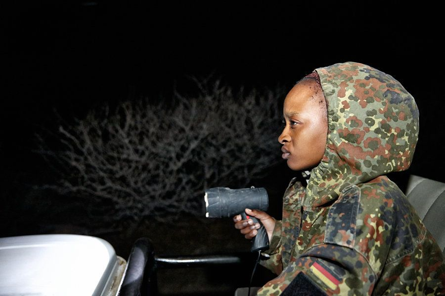 Felicia, armed with spotlight, on the look out for poachers.