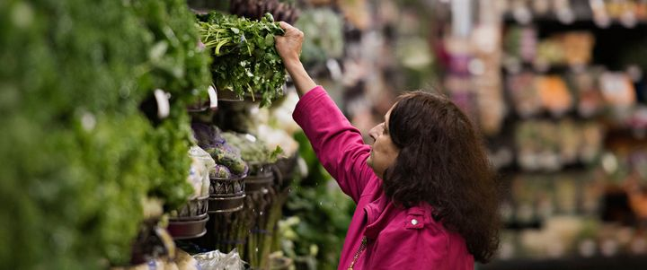 <p>A shopper shops for food at a grocery store in Illinois.</p>