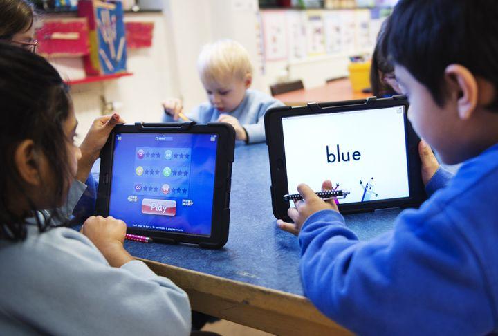 <span>Nursery school pupils work with iPads on March 3, 2014 in Stockholm.&nbsp;</span> &nbsp;