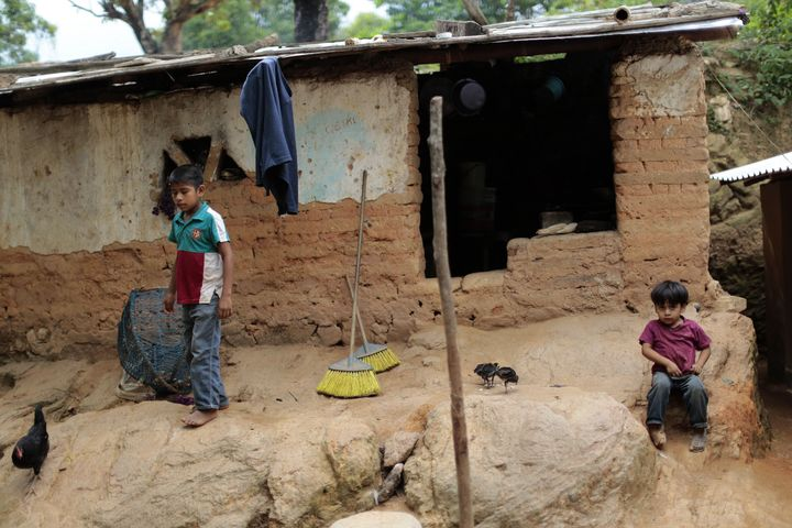 <span>Children stay in front of their humble home in El Magueyito, Guerrero State, Mexico, on July 19, 2015.</span> &nbsp;