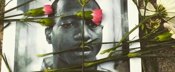 Flowers are scattered across a photo of Kalief Browder, who took his own life in June at the age of 22.