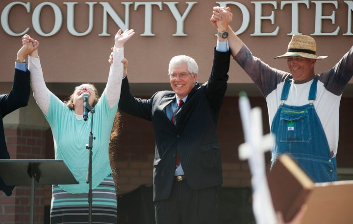 Mathew Staver, center, said Wednesday that forcing Kentucky county clerk Kim Davis, left, to do her job would be like making