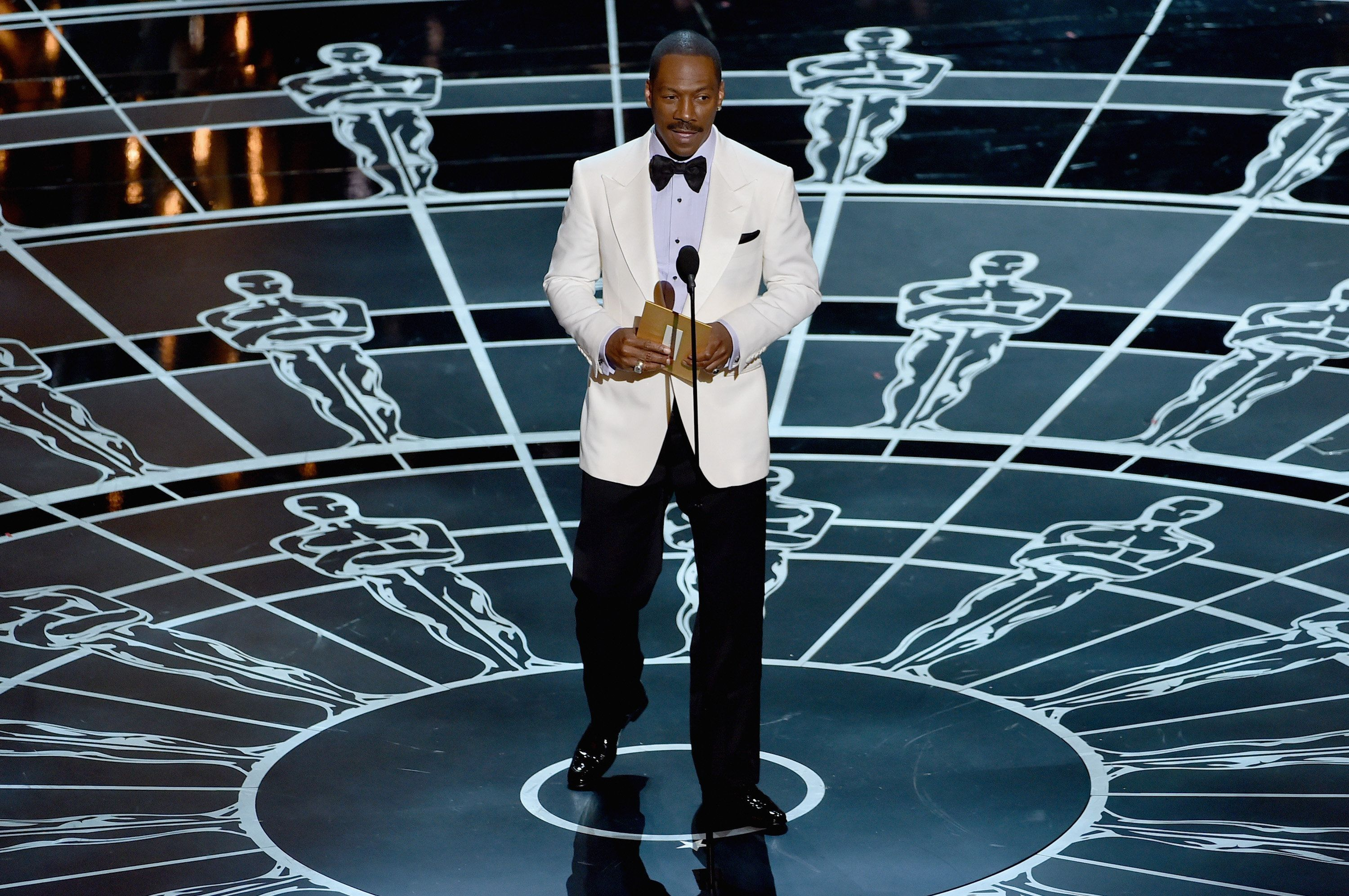 HOLLYWOOD, CA - FEBRUARY 22:  Actor Eddie Murphy opens the envelope onstage during the 87th Annual Academy Awards at Dolby Theatre on February 22, 2015 in Hollywood, California.  (Photo by Kevin Winter/Getty Images)