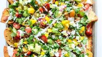 """<strong>Get the <a href=""""http://www.howsweeteats.com/2015/05/crispy-carnitas-oven-nachos-with-homemade-tortilla-chips/"""" target=""""_blank"""">Crispy Carnita Oven Nachos with Homemade Tortilla Chips recipe</a> from How Sweet It Is</strong>"""