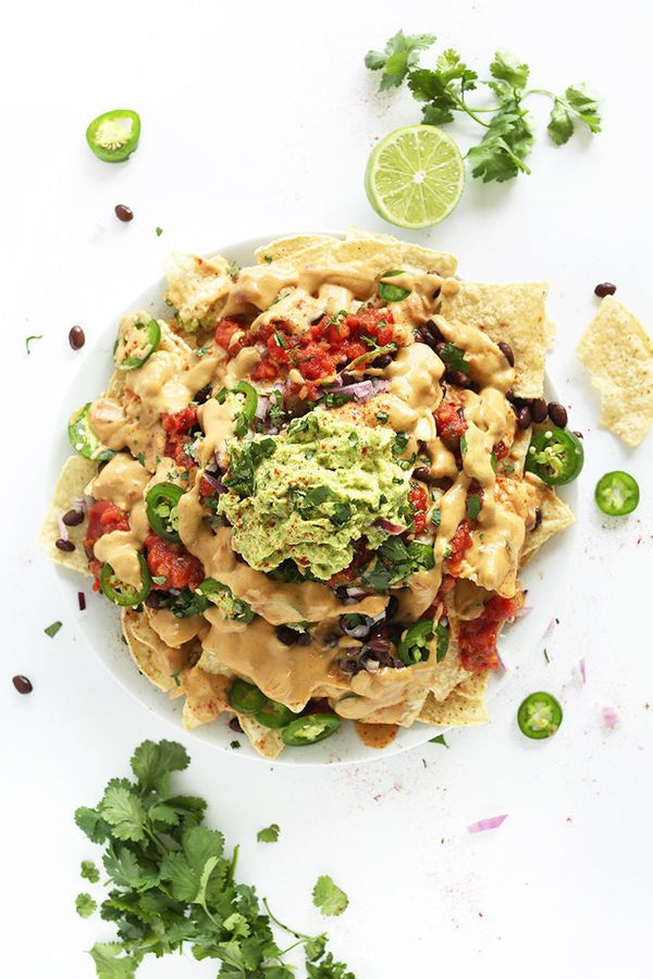 "<strong>Get <a href=""http://minimalistbaker.com/the-best-damn-vegan-nachos/"" target=""_blank"">The Best Vegan Nachos recipe</a>"