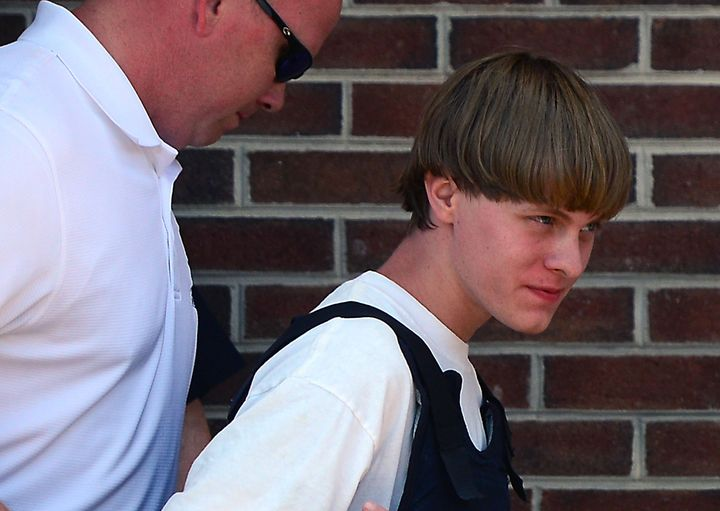 Charleston shooting suspect Dylann Roof is escorted from the police department on June 18, 2015, in Shelby, South Carolina.
