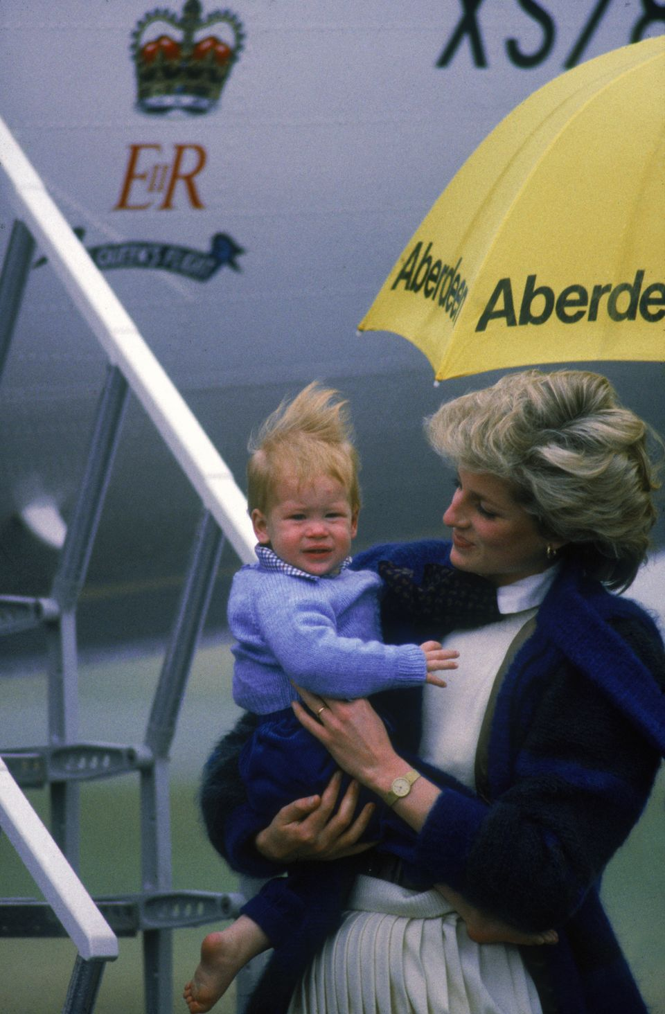 At the Aberdeen airport with his mom, Princess Diana.