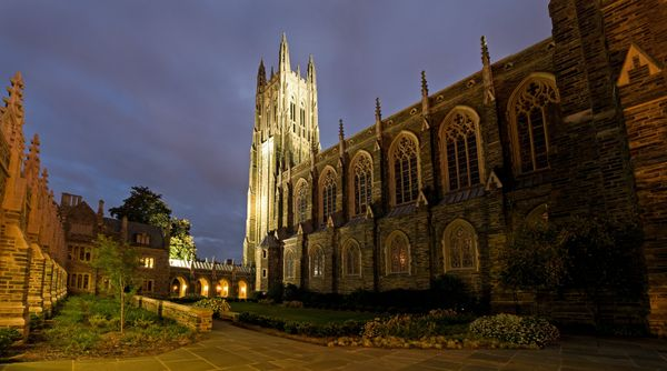 Duke University Chapel at night with clouds overhead.