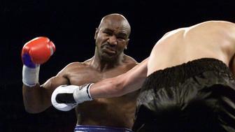 3 Mar 2001:  Evander Holyfield pulls back to throw a punch at John Ruiz during their WBA heavyweight championship bout at the Mandalay Bay Resort & Casino in Las Vegas, Nevada.  <DIGITAL IMAGE> Mandatory Credit: Jed Jacobsohn/ALLSPORT